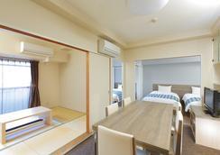 大手前住宿酒店 - 大阪 - 臥室