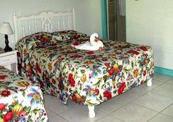 珊瑚海洋花園度假酒店 - 尼格瑞爾 - 臥室