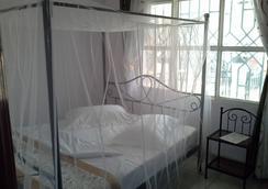 半徑客人公寓住宿加早餐旅館 - Kigali - 臥室