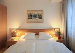 西蒙奇尼酒店 - 盧森堡 - 臥室