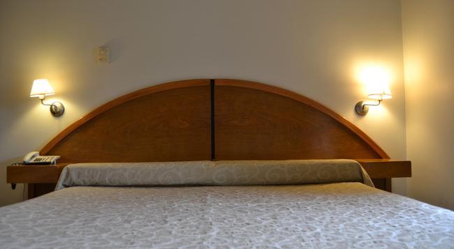 Apart Hotel Maue - 門多薩 - 臥室