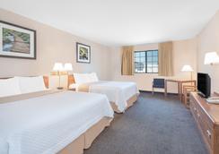 西拉皮德城戴斯酒店 - 拉皮德城 - 臥室