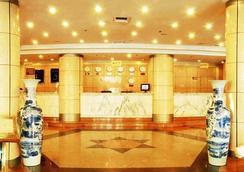 Qingdao Huaneng Hotel - 青島 - 大廳