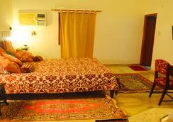 和諧酒店 - 克久拉霍 - 臥室