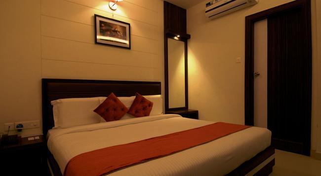 Hotel Premiere Villa - 瓦拉納西 - 臥室