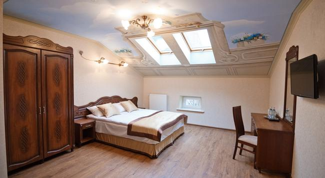 Guest House Inn Lviv - 利沃夫 - 臥室