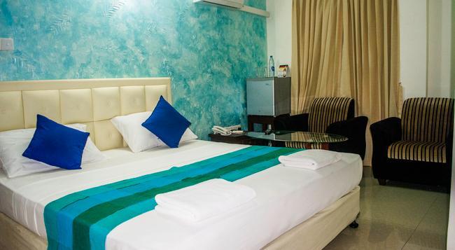 VJ City Hotel - 可倫坡 - 臥室