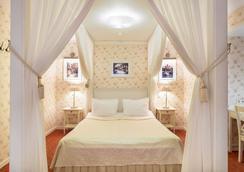亚历山大之家酒店 - 聖彼得堡 - 臥室