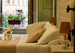羅坎達納沃納酒店 - 羅馬 - 臥室
